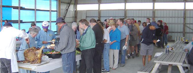 More than 80 people lined up for the delicious dinner buffet, cooked by a professional chef, provided in an airplane hangar at the funfly site.