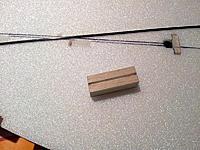 Name: fourreau-cle-ar.jpg Views: 11 Size: 273.8 KB Description: The rear CF rod's sheath is built from a hard balsa bloc...