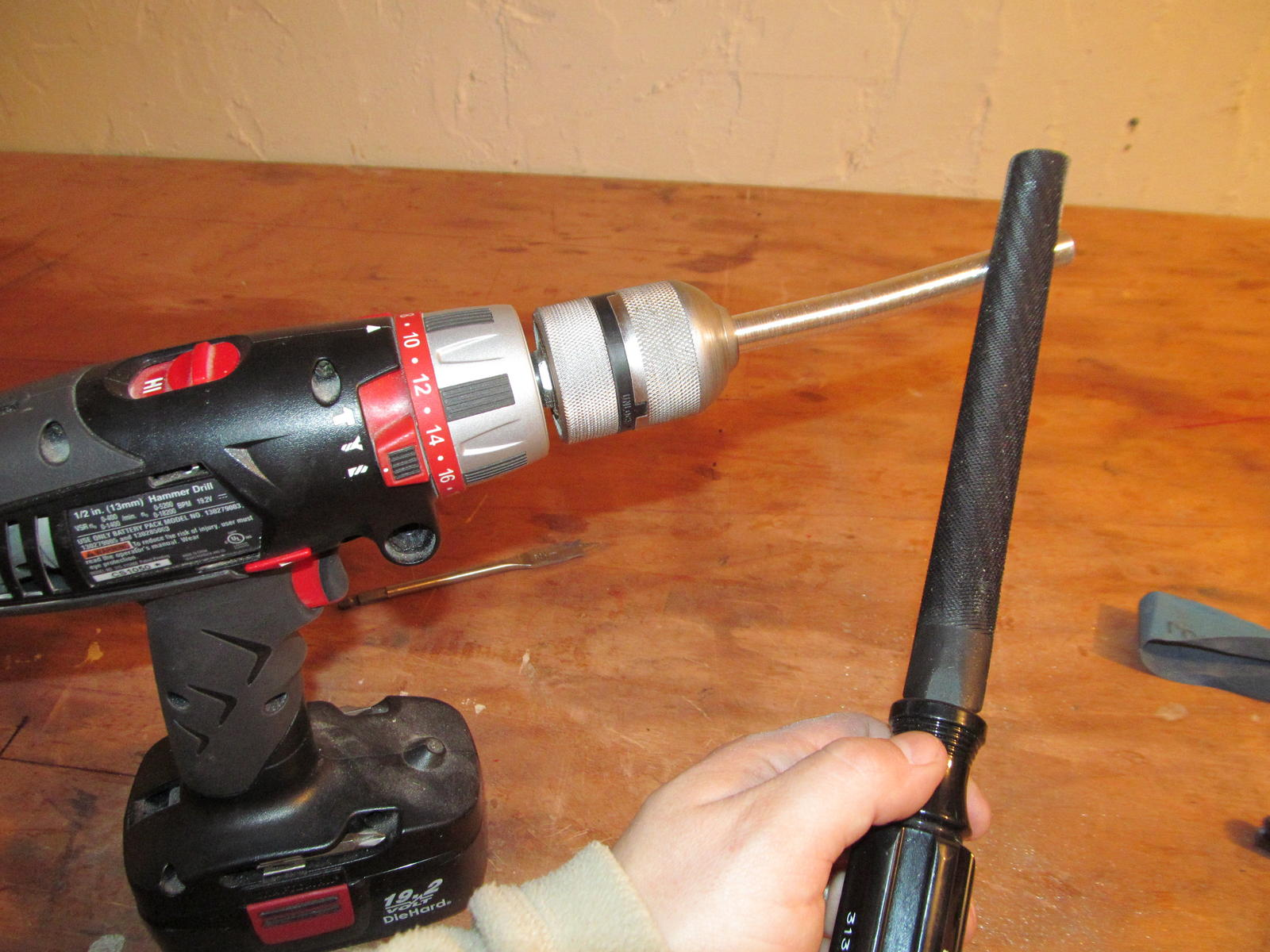 I start by chucking the joiner in my drill and using a metal file to remove material quickly.