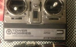 TOWER HOBBIES 4 CHANNEL FM RADIO, RECIEVER, AND RECHARGEABLE battery