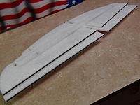 Name: 014.jpg Views: 64 Size: 566.1 KB Description: Glue small flat carbon spars to trailing edge of ailerons.