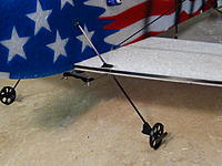 Name: 032.jpg Views: 72 Size: 663.1 KB Description: Assemble wheels with CA glue to the 2mm carbon rod, and glue to plane as shown using slots and holes provided.