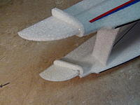 Name: 033.jpg Views: 66 Size: 594.8 KB Description: Glue counter balance supports to wings. Deflect ailerons down to aide in sliding supports in place.