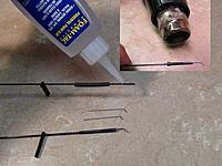 Name: 4 006.jpg Views: 59 Size: 702.3 KB Description: The wire control pieces can be easily attached to the carbon rods with Foam-tac glue and shrink wrap. The glue is flammable, so use a heat gun or hair dryer on the shrink wrap. The glue and shrink wrap can also be reheated to move and adjust the wire.