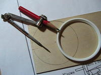 Name: 6 - Mark and cut thin plywood the size of rim - Compass marks center of wheel.jpg