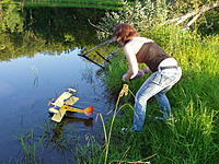 """Name: P1010017.JPG Views: 90 Size: 1.03 MB Description: Gerry decided that it was crucial that there should be a """"graceful"""" shot of me alighting Lil Fishy in ye olde ponde. He dubbed me something along the lines of """"Duchess of the Pond"""" or something ;)"""
