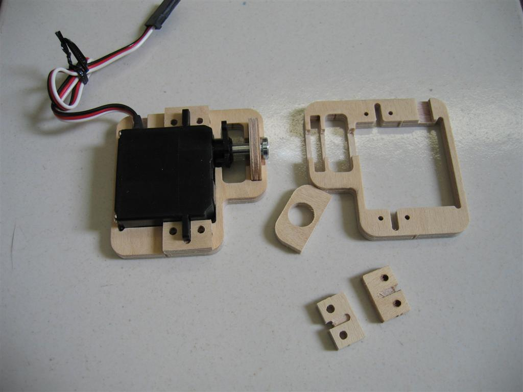 You'll get 4 of these VERY COOL servo frames/output arm bearings. Awesome idea to support the output shaft!