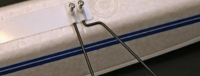 Gear legs and spreader wires are attached with screws.  Flat spots on the wires ensure proper alignment.