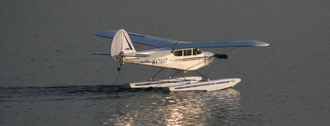Reflections off the water make watching the Super Cub on floats that much more fun.