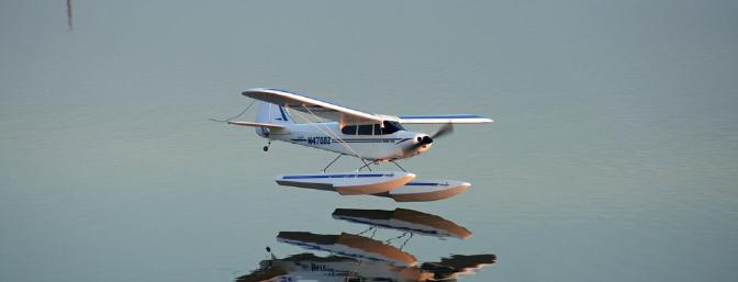 Glassy reflection as the Super Cub is about to touch down