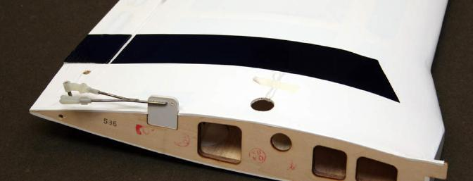 This shows the left wing panel and how the flaps are fixed.  There are multiple holes in the tab allowing for different flap settings.  Just break the tab off if you install the flap servo.
