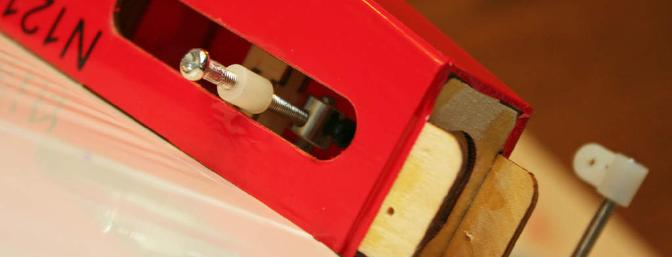 The rudder control horn protrudes from the slot in the side of the fuselage.  Note the control-horn collar with the black set screw.
