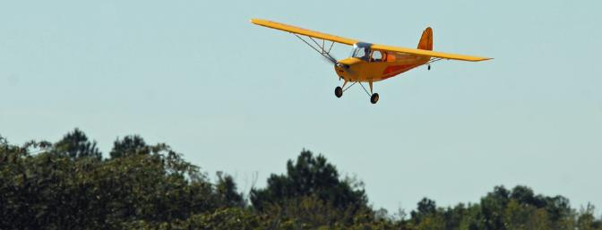 Aeronca purposely didn't put flaps on the Champ because they just didn't look as cool as a nice slip on final approach.  OK, maybe I'm making that up, but slips do look cool.