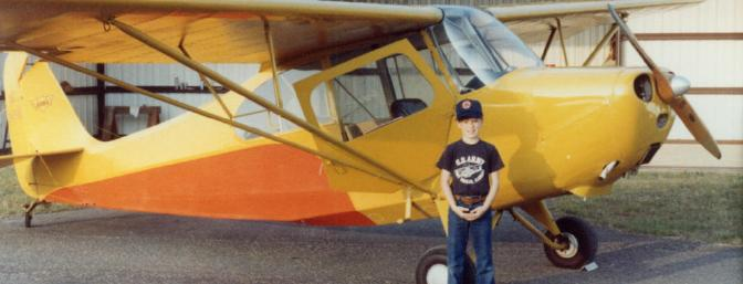 Here I am standing beside Dad's Champ in Enterprise, AL, ca. 1981.  I was styling with the blue Nikes with a yellow swoosh!