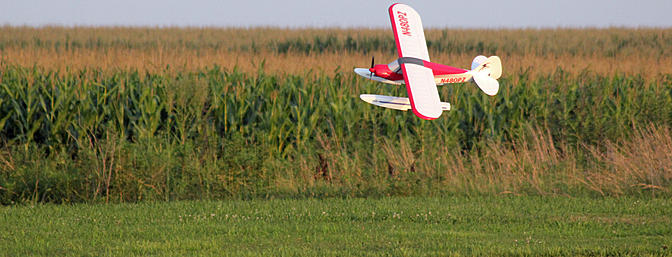 Sport Cub cruising past the corn on the far side of the pond.