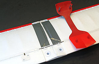 Once the wing panels are slid together on the joiner tube, you're ready for the plastic wing cover.  Note the plastic-reinforced holes in the center section.