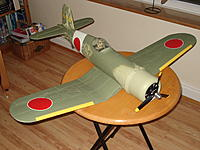 Name: J1 development 19.jpg Views: 79 Size: 172.9 KB Description: Even the pilot was painted to match a colour photo I have of three Kamikaze  pilots.  The cockpit was done in 'near' Japanese colours.  A bit obsessive I know...