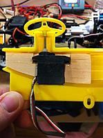 Name: IMG_1057.jpg Views: 282 Size: 117.5 KB Description: View of the underside shows the balsa support, small servo glued to balsa and 2/56 threaded rod attached to servo and the steering wheel threaded on the threaded rod.