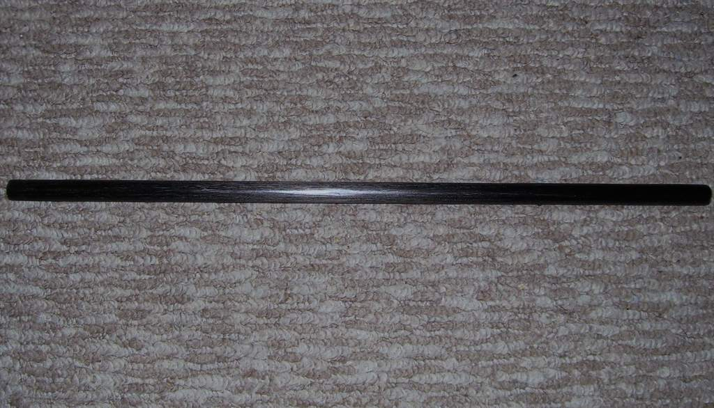Carbonfiber rod, cut down, sanded down, and polished.