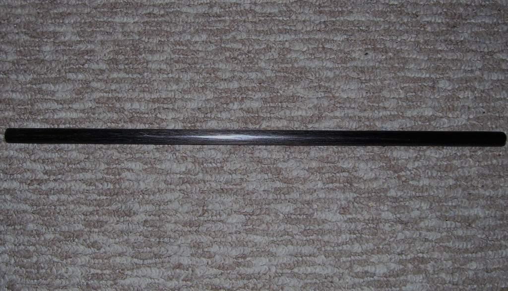 Name: 100_0528.jpg Views: 251 Size: 97.0 KB Description: Carbonfiber rod, cut down, sanded down, and polished.