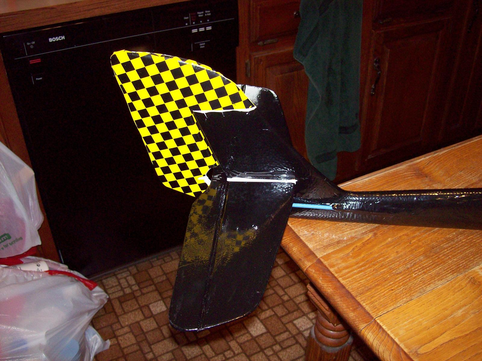 Black and Yellow checks for rudder, black Econocoat for vertical and hoizontal stabs, and tail.