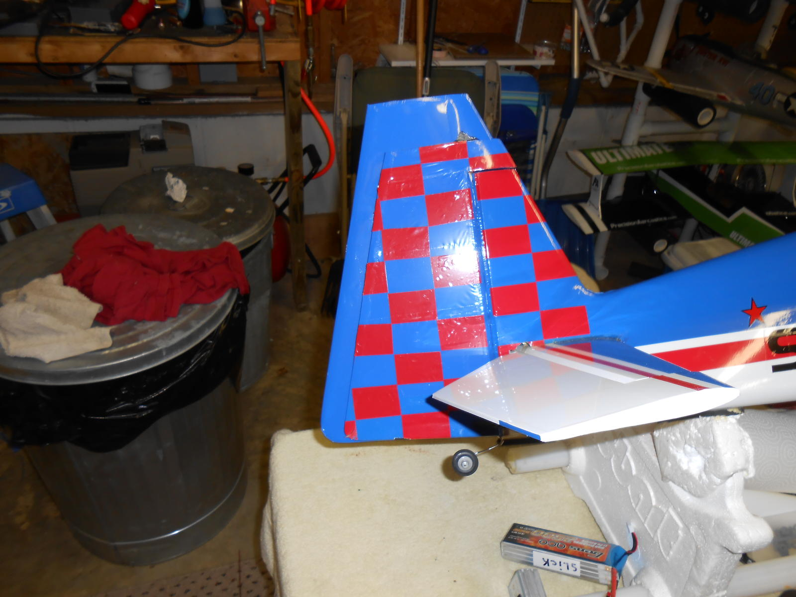 New rudder taped to the back of stock rudder