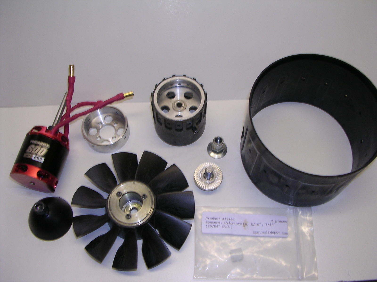 All the goodies. Plastic bag contains special order nylon bushing for fan hub. Zero play in fan/adapter mating.