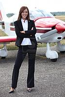 Name: 13380525-young-woman-standing-in-front-of-an-airplane.jpg