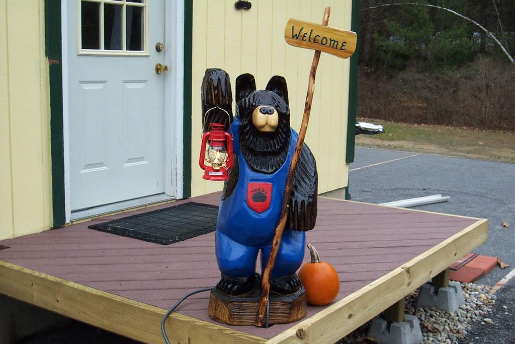 Bernie our Adirondack Chainsaw carved bear standing guard.