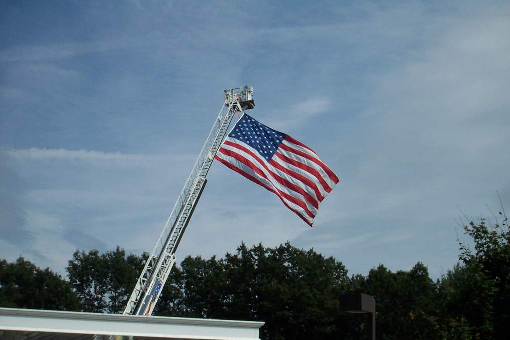 Old Glory from a fire truck boom Just down the road at Stewart's Shop