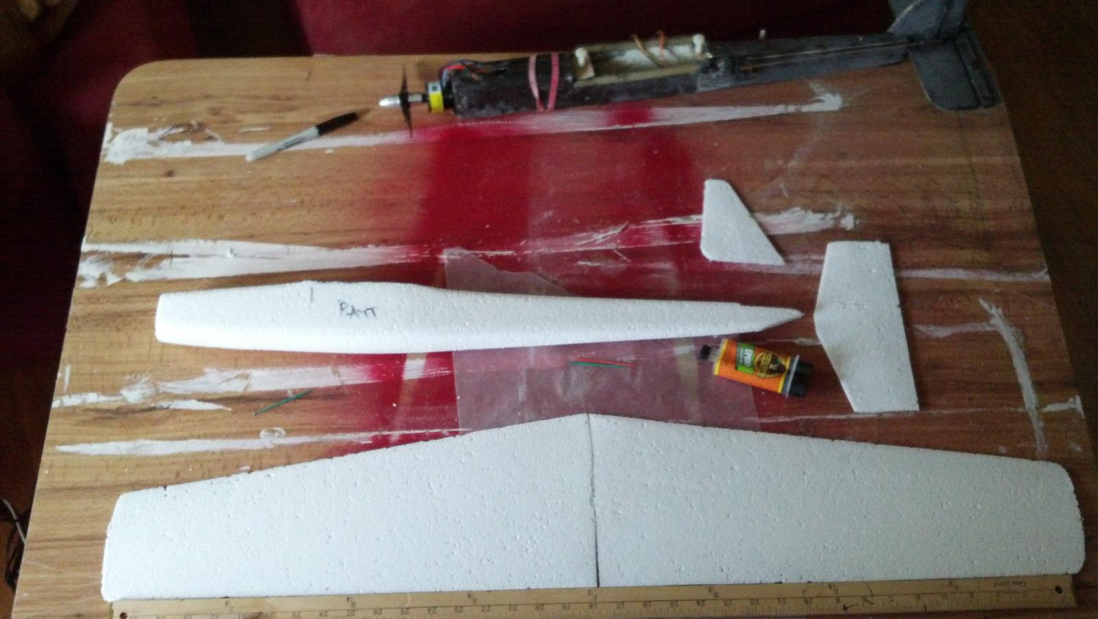 Shaped foam, ready for layup. You can see the prototype above the foam... flew good as long as you keep the speed up, stalled reallllyyy easily due to a poorly built wing [yes I built it :) ]