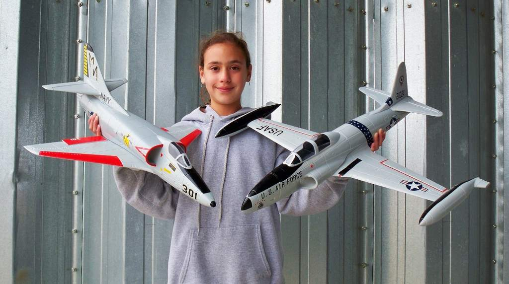 My daughter Evelyn, RC pilot holding the 50mm A-4 & T-33 from Toysonics.