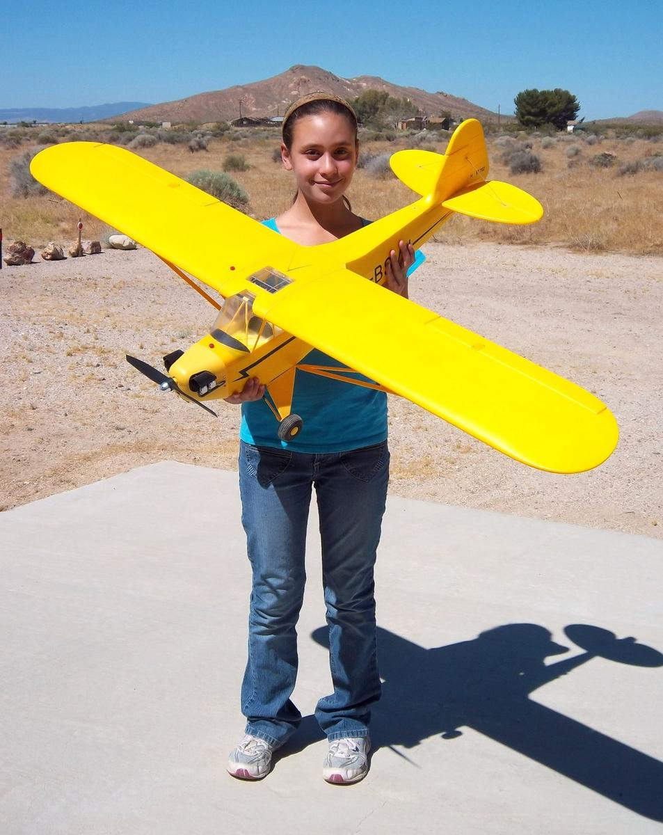 My daughter Evelyn holding the New Airfield 1400mm J-3 Cub from Nitroplanes.