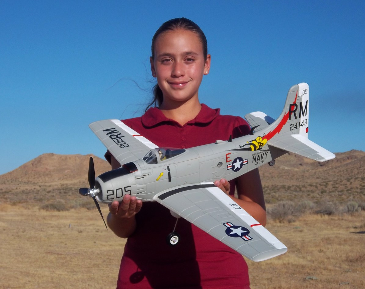 My awesome daughter Evelyn holding this new Airfield 800mm A-1 Skyraider from Nitroplanes.com