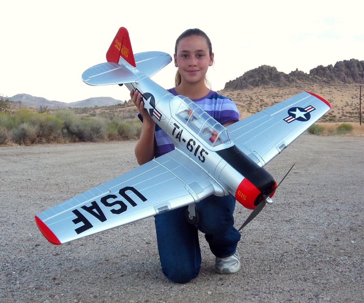 My awesome daughter Evelyn holding our new Dynam AT-6 Texan from Nitroplanes.com