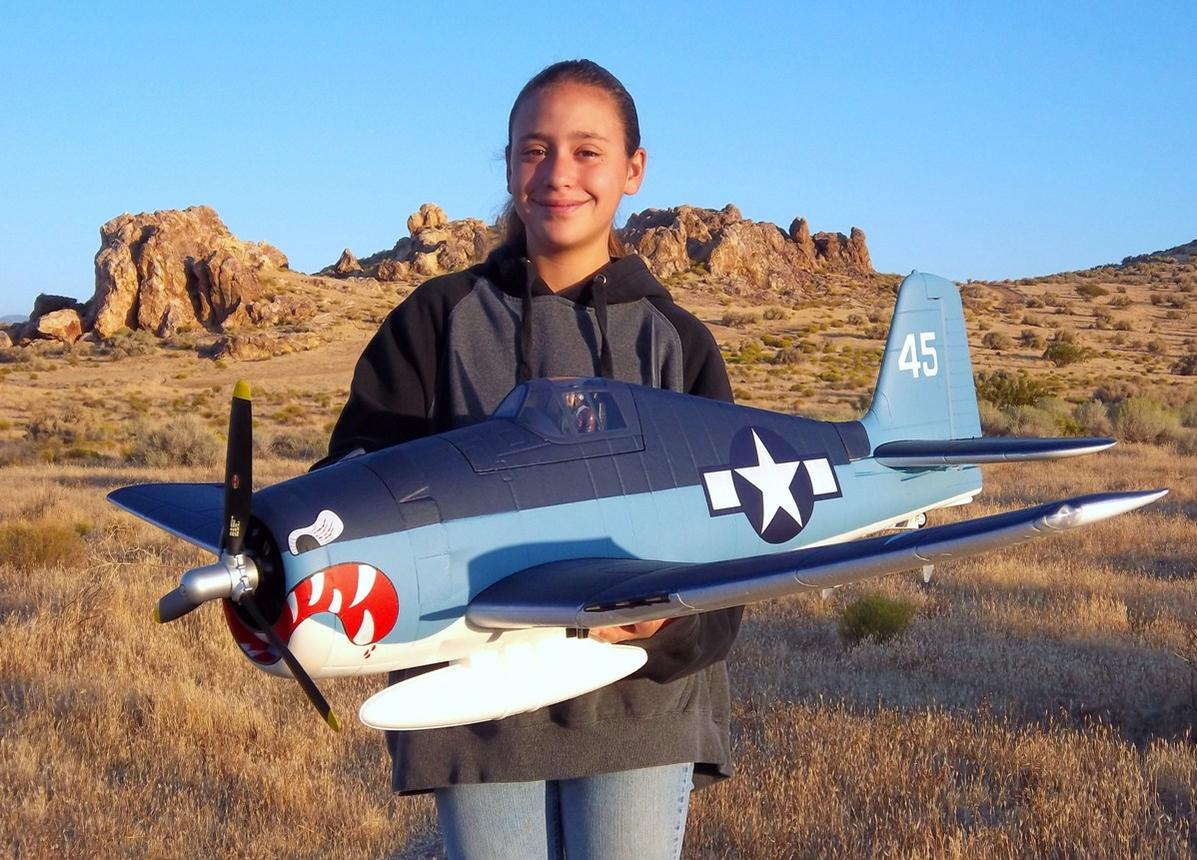 My awesome daughter Evelyn holding our new Airfield 1400mm F6F Hellcat from Nitroplanes.com