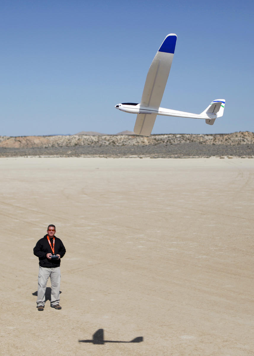 Master Sgt. Anthony Accurso, 412th Maintenance Squadron NCO in charge of Aerospace Ground Equipment Flight and Muroc Model Master club safety coordinator, flies his radio controlled Parkzone Radian powered glider over the Rosamond Dry Lake Bed Feb. 26.