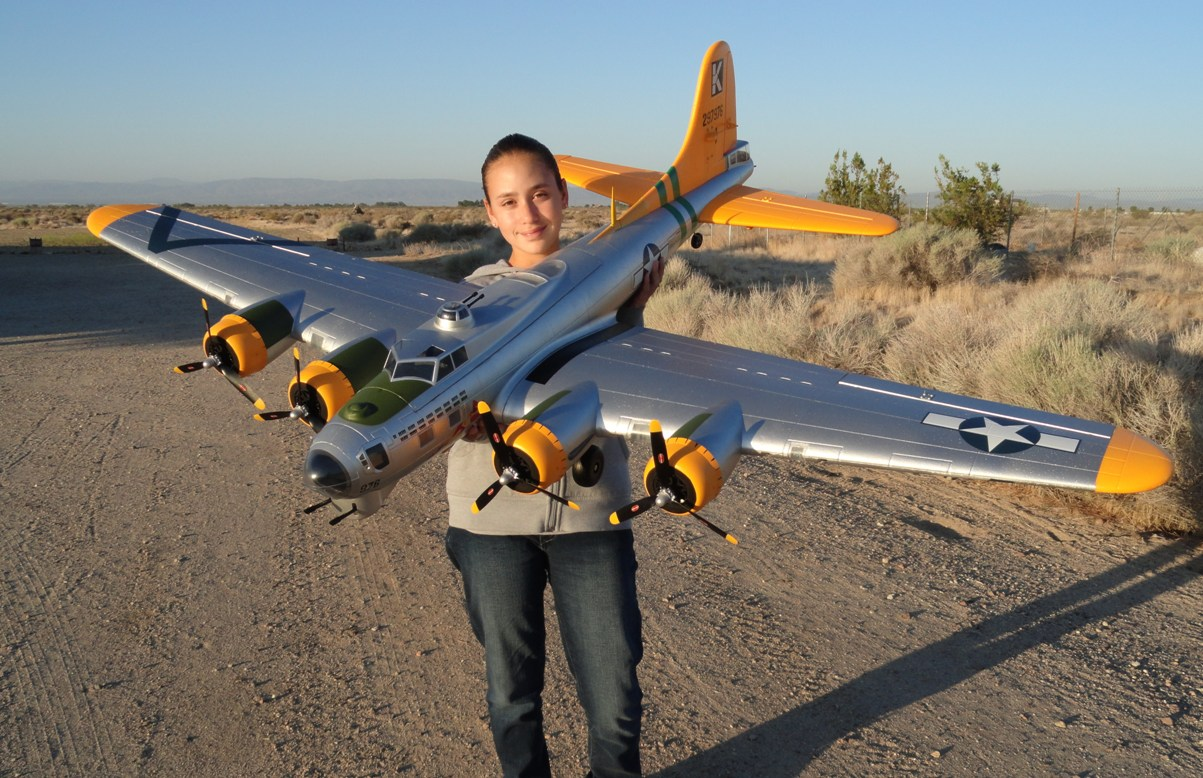 "RC Pilot Evelyn holding our New Starmax B-17 ""A Bit-O-Lace"""