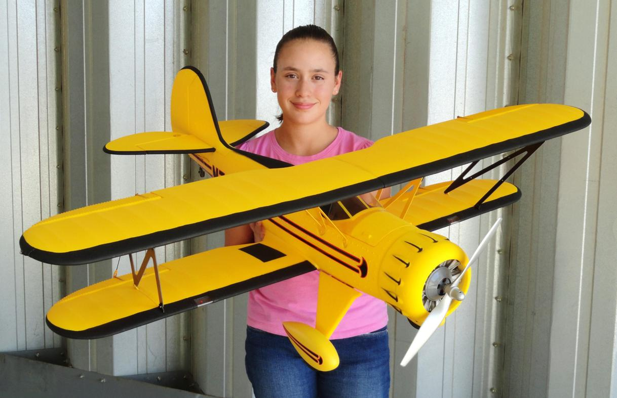 RC Pilot Evelyn holding the New Dynam Waco YMF-5D available from Nitroplanes.com