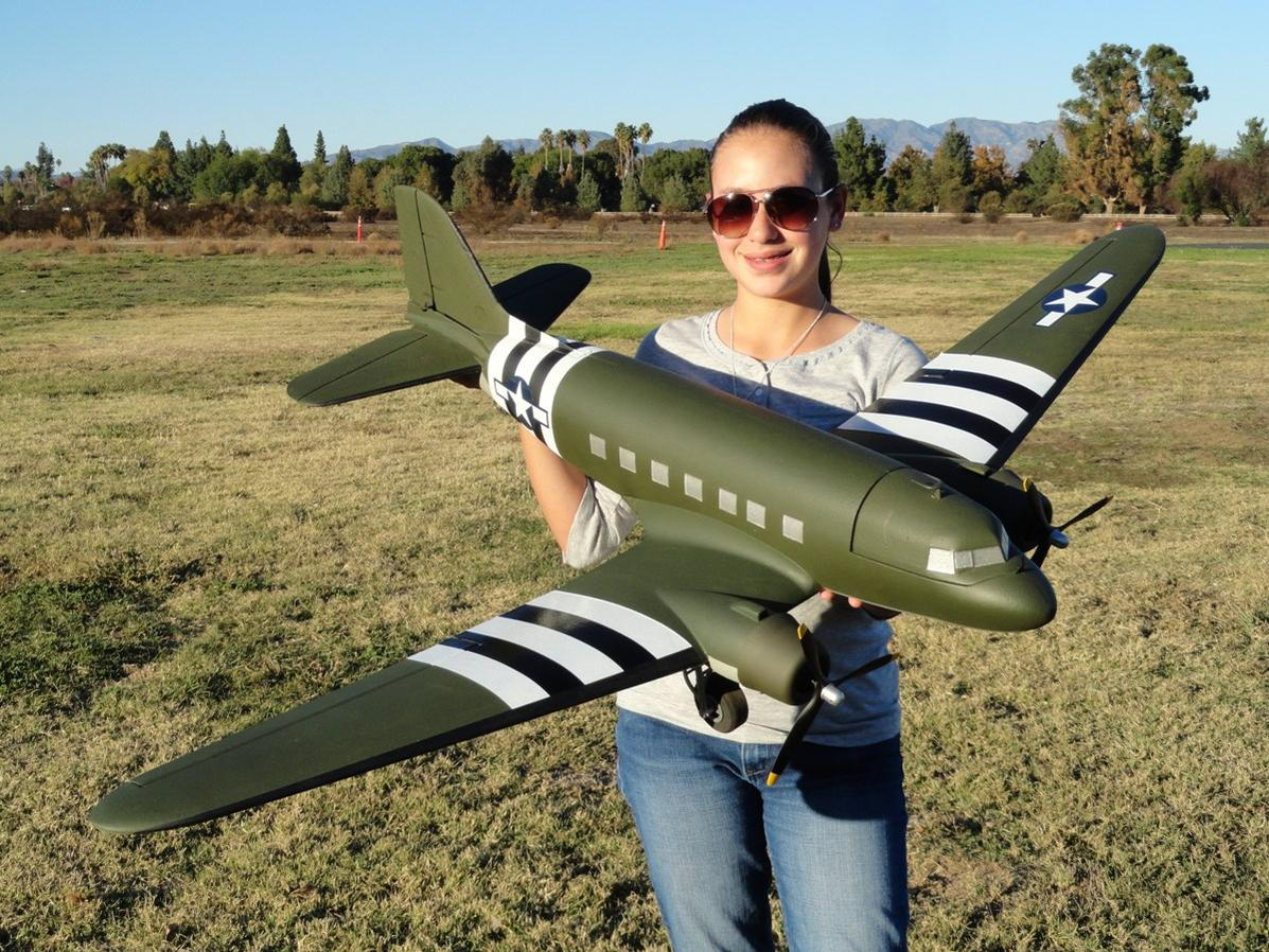 RC Pilot Evelyn holding the Dynam C-47 from Nitroplanes.com