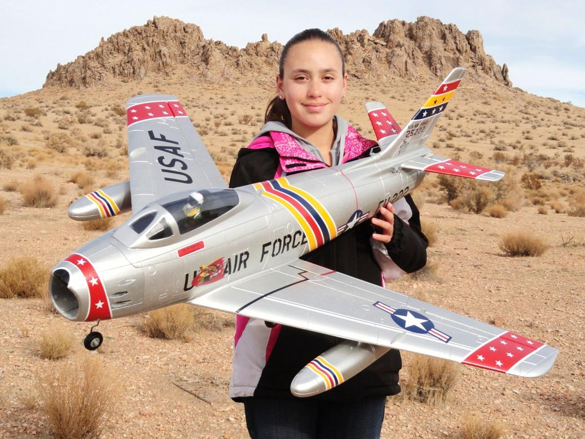 RC Pilot Evelyn holding the Starmax 70mm F-86 from Hobby King