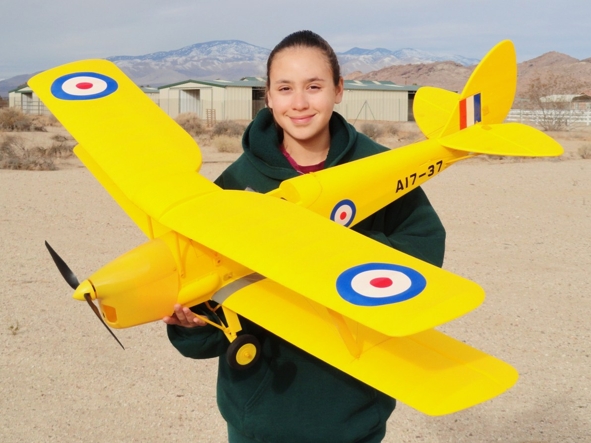 RC Pilot Evelyn holding the New Dynam de havilland Tiger Moth from Nitroplanes.com
