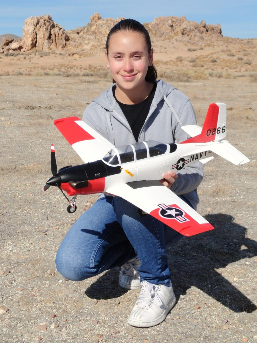 RC Pilot Evelyn holding the New Airfield 750mm Wingspan T-34 Mentor from Nitroplanes.com