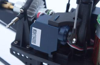 The servos are held tightly between the plastic frame.