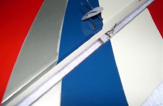 Installing aileron hinges.