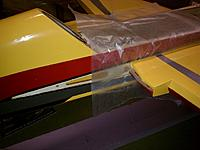 Name: small_IMG_20120103_080822.jpg Views: 273 Size: 90.5 KB Description: Instructions say to use plastic to keep the wing from accidentally getting glued to the fuse. I went with wax paper because it was handy.