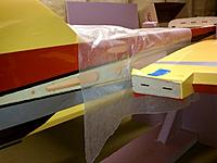 Name: small_IMG_20120103_081011.jpg Views: 274 Size: 91.7 KB Description: Brush 30 min epoxy onto the main wing and the wing extension