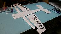 Name: 20150112_214818[1].jpg Views: 30 Size: 287.7 KB Description: Glue the aileron sections of the wing back to the leading edge and fuse sides. Gluing only the wing portion of the section. The ailerons must remain movable ahead and behind the hinge line.