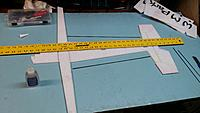 Name: 20150112_214330[1].jpg Views: 34 Size: 399.0 KB Description: Glue on the horizontal  stab as well as flat carbon to the fuse sides. Make sure  the wing is square to the fuse but measuring from wing tip to the tail on both sides. The tabs should also be in a straight line as shown in this picture.