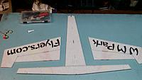 Name: 20150112_213831[1].jpg Views: 29 Size: 326.4 KB Description: Remove the aileron section s by cutting the small foam bridges holding it together.  Glue on the section between the horizontal stab and main wing.